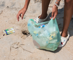 cleaning plastic pollution on the beach