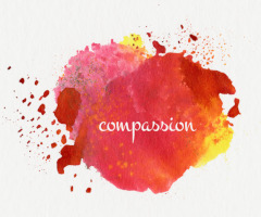 Watercolor splashes with the word Compassion written