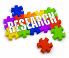 The word Research imposed over colered puzzle pieces